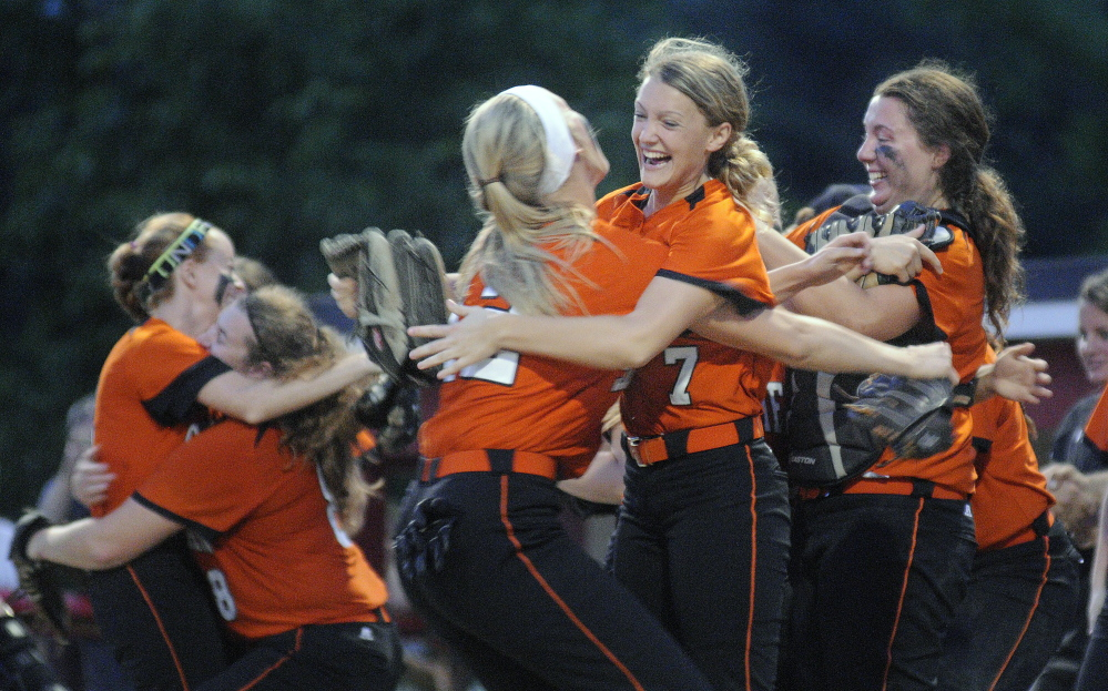 ONE MORE WIN: The Skowhegan softball team will hope to have this same sort of celebration today when the Indians play Thornton Academy for the Maine Class A softball state championship.