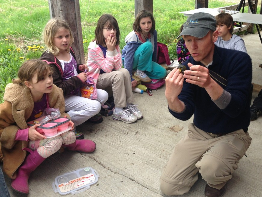 Patrick Keenan, outreach director, talks to children from Maple Tree Community School in Manchester.