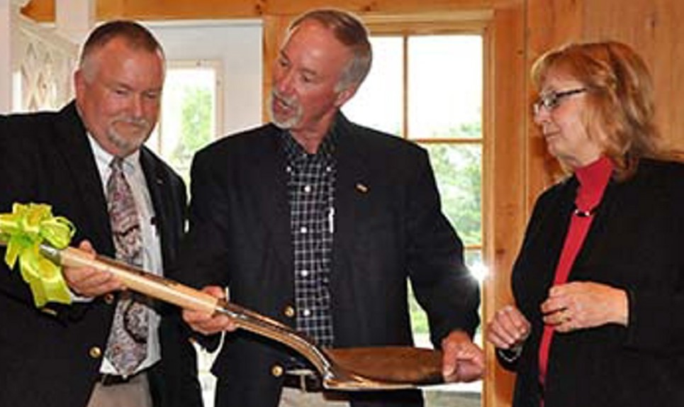 Capital campaign celebration: Mac Cianchette, left, receives ceremonial shovel from Mike Gallagher, center, and Terri Vieira at the Sebasticook Valley Health Center capital campaign finale event in Palmyra