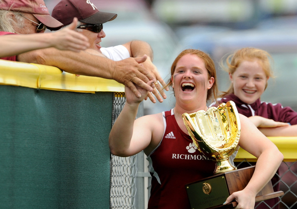 Winner: Richmond High School's Kalah Patterson, 14, high-fives fans as she runs around the field with the Class D championship trophy after defeating Limestone 11-5 at Brewer High School on Saturday.