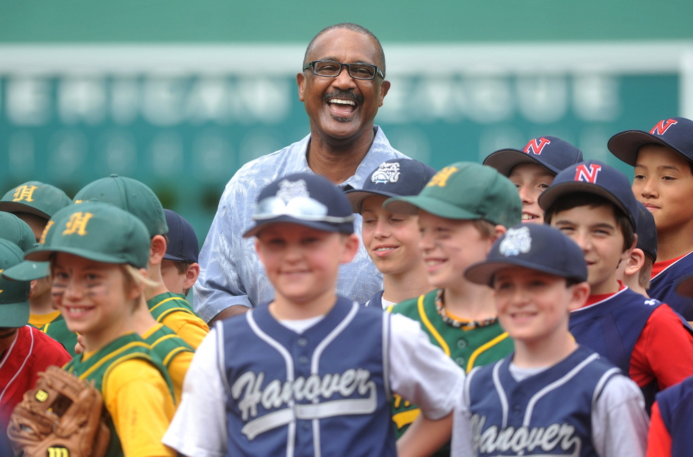 Having fun: Jim Rice stands with young baseball players Saturday during the dedication of Mini Fenway Park's new all-turf field Saturday on McGrath Pond Road in Oakland.
