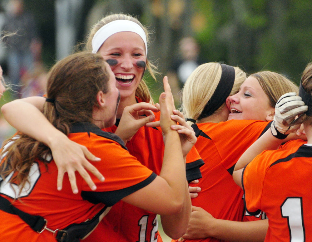 Celebration: Skowhegan players celebrate after beating Thornton Academy 7-2 to win Class A softball state championship on Saturday on Bailey Field in Standish.