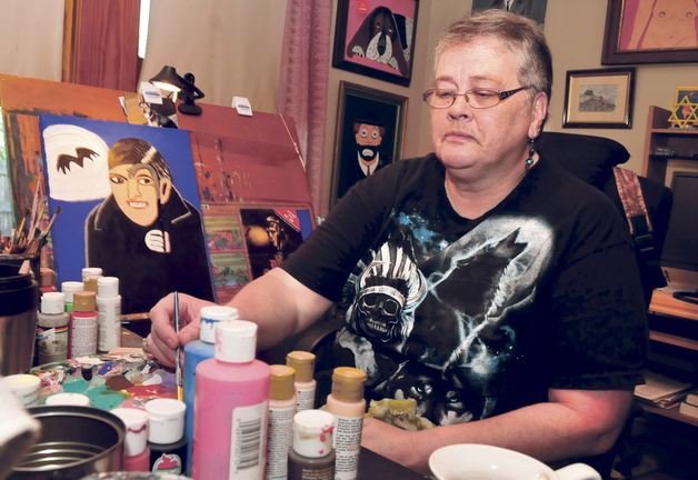 """Beverly Busque, of Waterville, works on a painting of a """"Dark Shadows"""" image."""