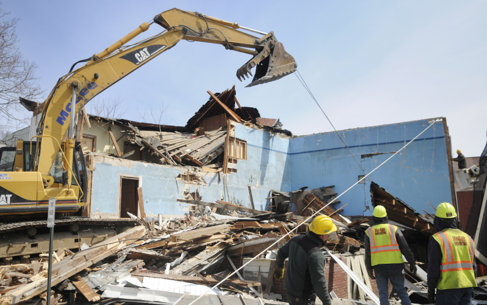 Workers with McGee Construction pulled down walls of the Masonic Lodge in Winthrop in April to make way for expansion of the Charles M. Bailey Public Library. To help pay for it, the Town Council plans to include $300,000 for the project in a larger bond encompassing other town needs.