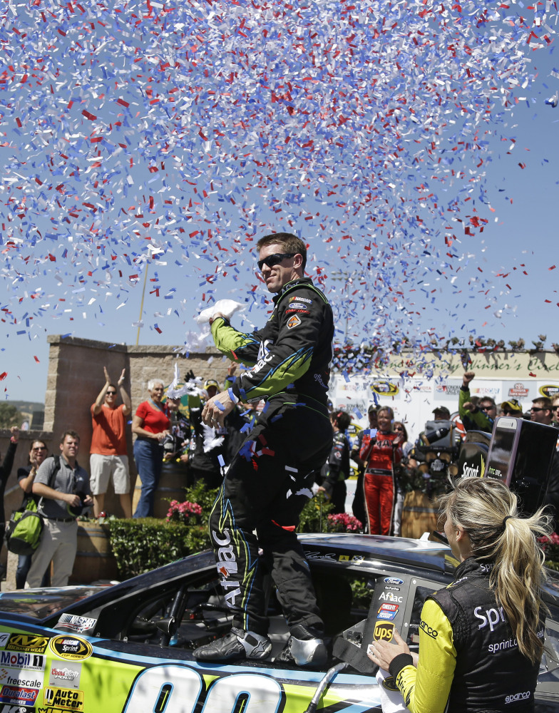 AP photo Carl Edwards stands atop his car after winning the NASCAR Sprint Cup Series race on Sunday in Sonoma, Calif. Jeff Gordon finished in second place.