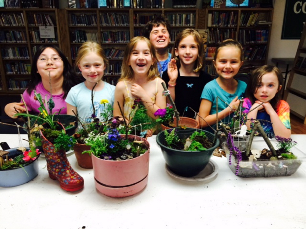 Students with their fairy container gardens, from left, are  Isavel LuxSoc, Ella Saphia Moore, Addison Turner, Emily Nichols, Kate Nichols, Emily Kynn Carlson and Lilian Rispoli. The Nichols girls are from Winslow, the other children live in Palermo.