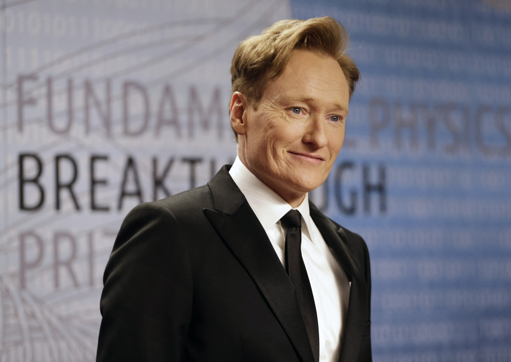 In this Dec. 12, 2013, file photo, talk show host Conan O'Brien arrives for the Breakthrough Prize in Life Sciences awards in Moffett Field, Calif.