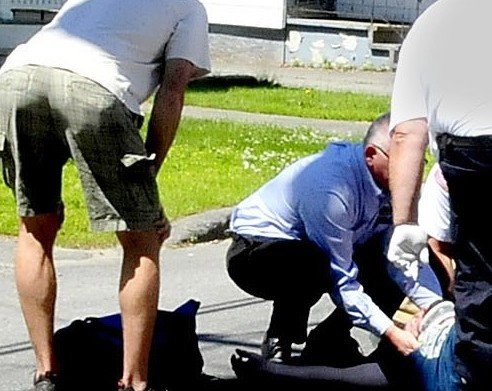 A male motorcycle operator is treated at the scene and later transported to the hospital following a collision with a vehicle at the intersection of Pleasant Street and Western Avenue in Waterville on Monday, June 23, 2014.