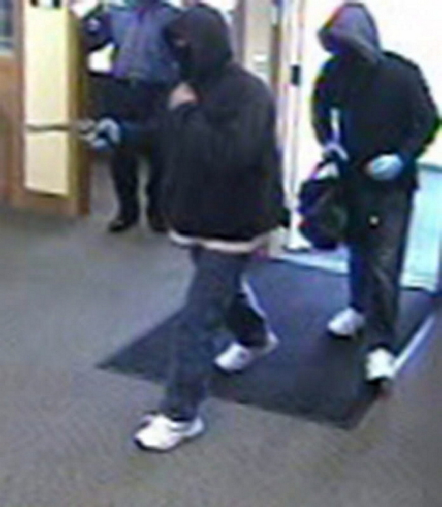 Two robbers are shown in a security camera image from Kennebunk Savings Bank on Oct. 19, 2013. Philip G. Gage was sentenced Monday for his role in this and other robberies.