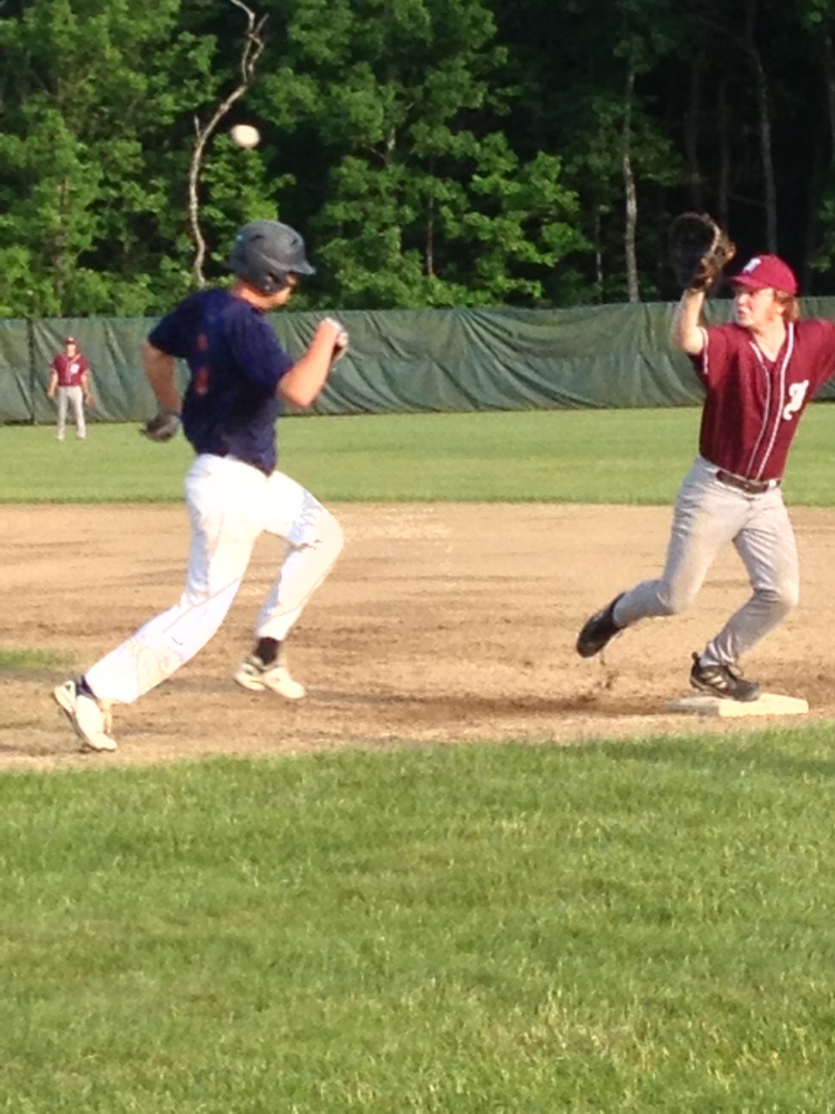 Staff photo by Matt DiFilippo   Post 51's Jake Dexter hustles to first as Franklin County first baseman Charlie Martin reaches for the throw during a Zone 2 game Monday night.