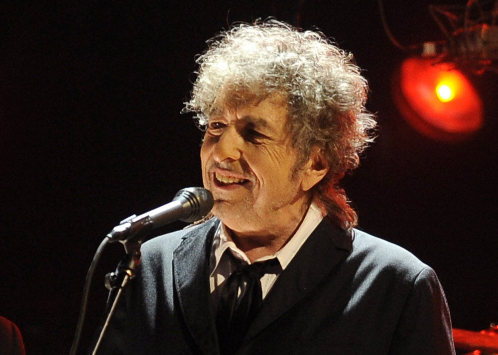 """Bob Dylan performs in Los Angeles in this 2012 photo. Sotheby's described the unidentified seller of a handwritten draft of Dylan's """"Like a Rolling Stone"""" as a longtime fan from California """"who met his hero in a non-rock context and bought directly from Dylan."""""""