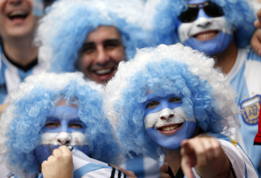 Argentina fans smile prior to the group F World Cup soccer match between Nigeria and Argentina at the Estadio Beira-Rio in Porto Alegre, Brazil, Wednesday, June 25, 2014. (AP Photo/Victor R. Caivano)