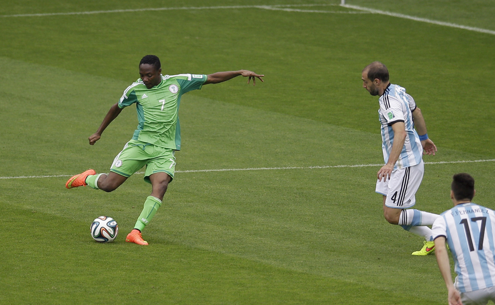 Nigeria's Ahmed Musa, left, scores his side's first goal during the group F World Cup soccer match between Nigeria and Argentina at the Estadio Beira-Rio in Porto Alegre, Brazil, Wednesday, June 25, 2014. (AP Photo/Michael Sohn)