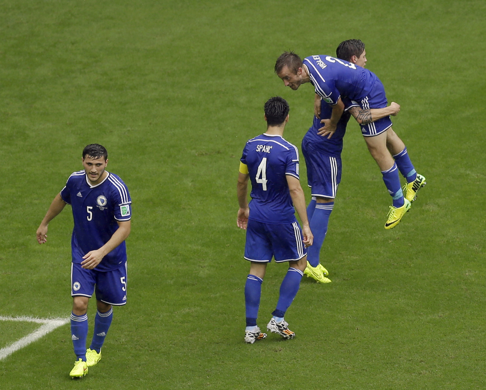 Bosnia defender Avdija Vrsajevic, right, celebrates his goal with his teammates during the second half of a group F World Cup soccer match against Iran.