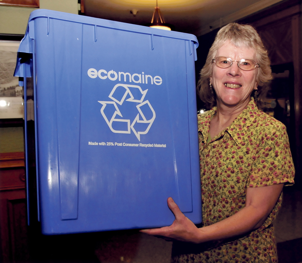 Linda Woods, a coordinator for Sustain Mid Maine Coalition, holds a recycling bin that will be available to residents for single-sort recycling. All recycleable materials will be tossed in the same bin. Some will be available Friday from 11 a.m. to 7 p.m. at Elm Plaza. Ecomaine will distribute the bins and offer advice on recycling.