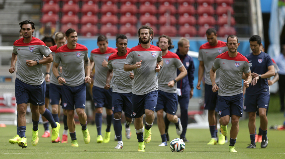United States' Kyle Beckerman, center, jogs with teammates during a training session Wednesday in Recife, Brazil.. The United States will play Germany today.