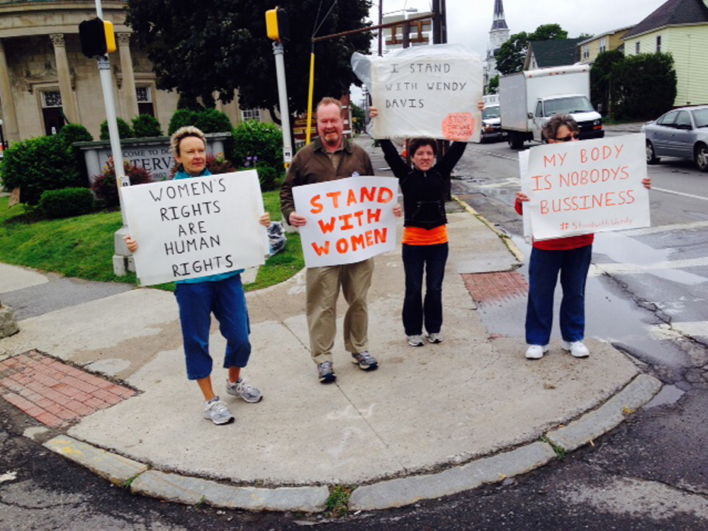 In this file photo, former Waterville Mayor Karen Heck, along with Alan Tibbetts of Sidney; Winslow resident Mindy Bergeron-Lawrence and Penny Rafuse of Waterville demonstrate in support of women's reproductive rights at the corner of Elm and Main streets in downtown Waterville.