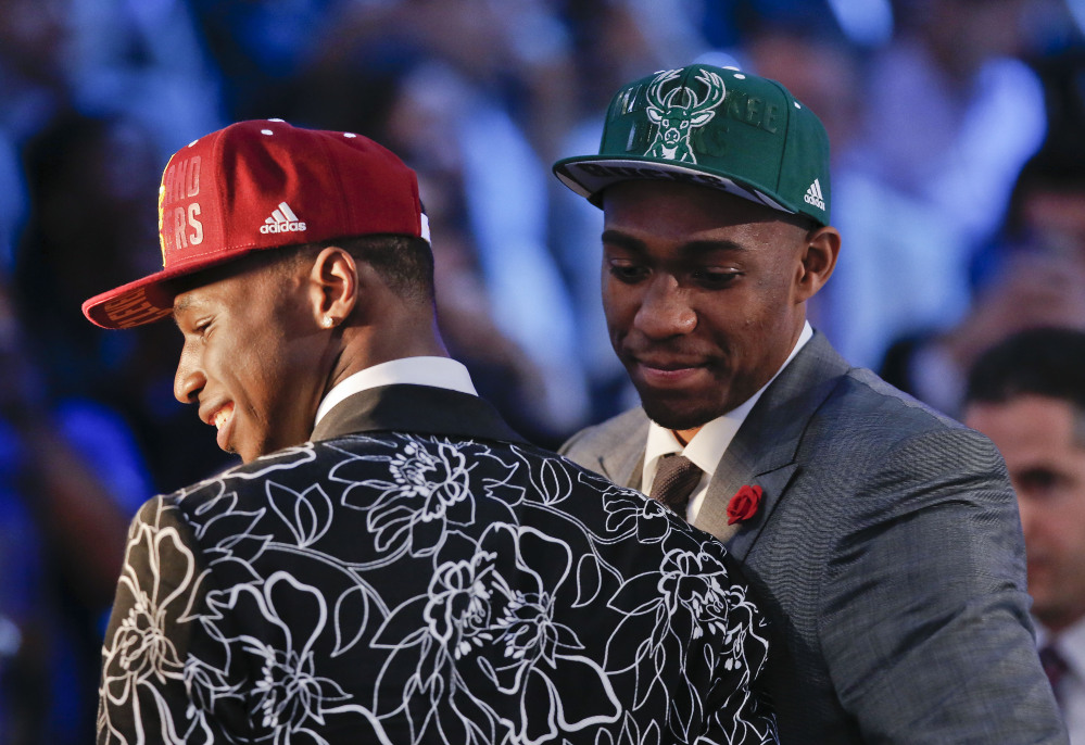 Andrew Wiggins, left, and Jabari Parker stop for television interviews after being selected as the top two picks in the 2014 NBA draft, Thursday, June 26, 2014, in New York. Wiggins was selected number one by the Cleveland Cavaliers and Parker was chosen number two by the Milwaukee Bucks.