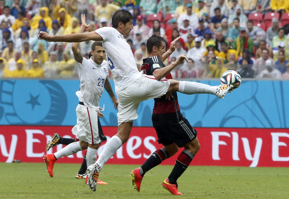 United States center back Omar Gonzalez, left, and Germany's Miroslav Klose challenge for the ball during the Group G World Cup soccer match between the USA and Germany on Thursday at the Arena Pernambuco in Recife, Brazil. Germany beat the US 1-0.