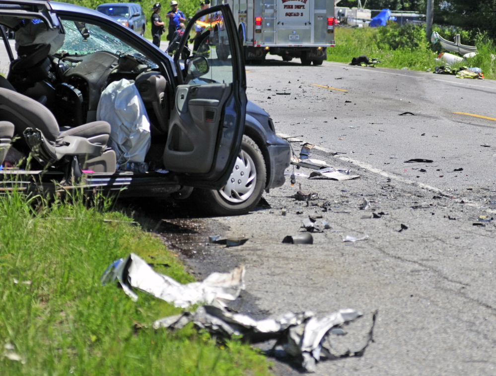 This van on one side of U.S. Route 202, left, and a white car on the other side, top right, were involved in a head-on collision on Friday near TJ's Place in Monmouth.