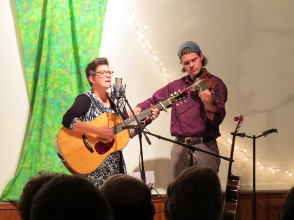 Ruth Hill, left, and Silas Rogers performing at the Chesterville Center Union Meeting House fundraiser recently.
