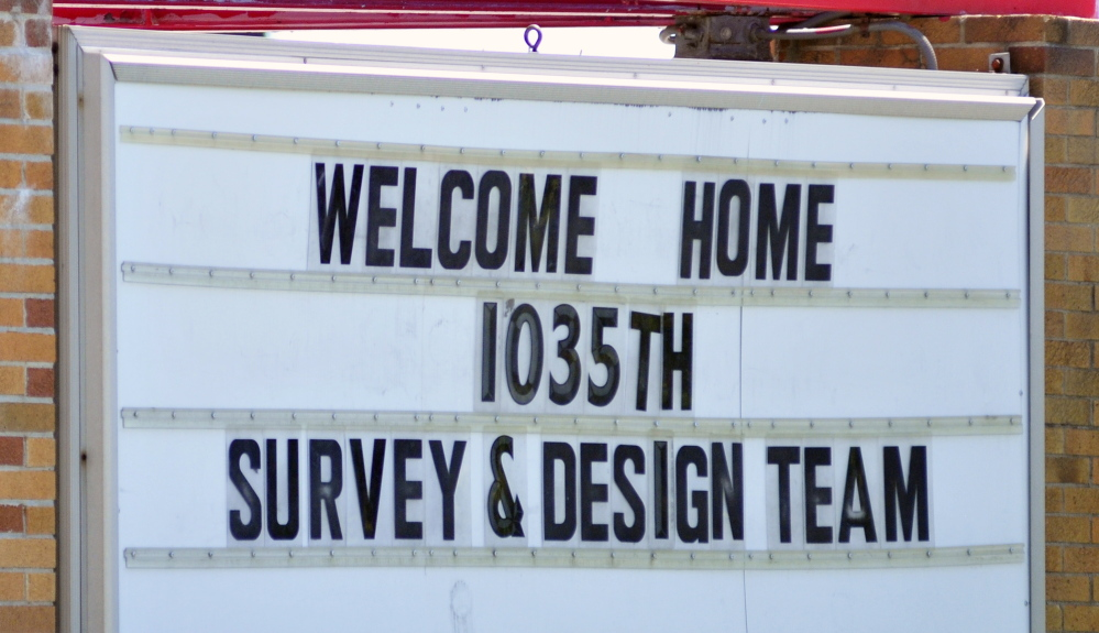A sign in front of the Augusta Armory welcomes the soldiers home on Friday.