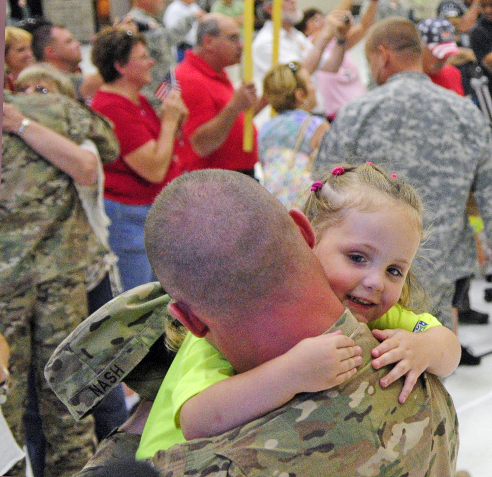 Sgt. Casy Nash, left, hugs his daughter Althea Nash on Friday at the Augusta Armory.