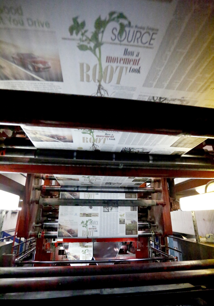 The first installment of Source rolls off the presses on April 3 at the MaineToday Media's printing plant in South Portland. The new section is one of many changes that are underway with the business.