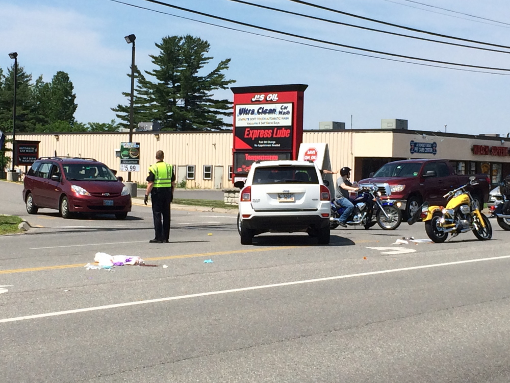 A motorcyclist was taken to the hospital by ambulance for a head injury following a collision with a Jeep outside J&S Oil on Kennedy Memorial Drive on Saturday.