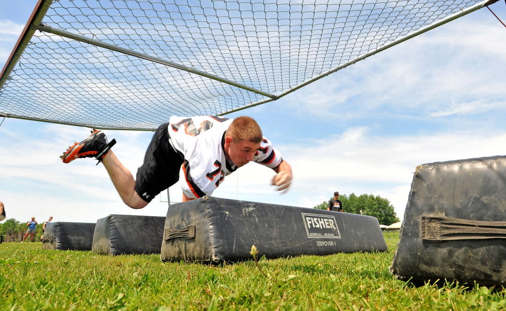 Skowhegan Area High School's Dan Laweryson competes in the bear crawl event during the annual Big Man Battle For Brotherhood competition Saturday at Skowhegan High School.