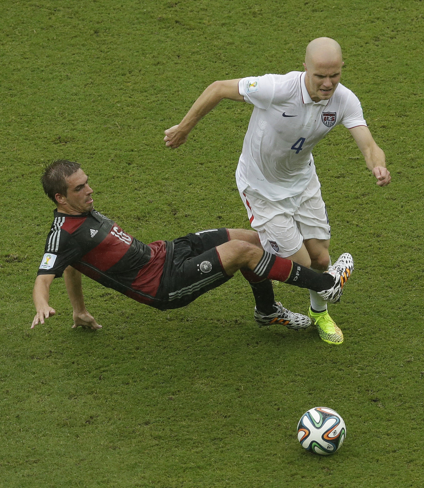 Germany's Philipp Lahm challenges Michael Bradley (4) of the United States for the ball during a recent World Cup soccer match between the USA and Germany at the Arena Pernambuco in Recife, Brazil.