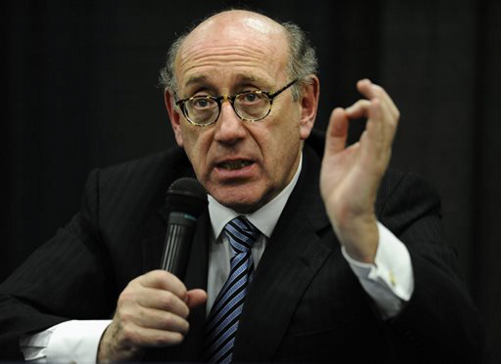 In this July 2013 photo, attorney and special adviser Kenneth Feinberg speaks at a public forum on the distribution of Newtown donations at Edmond Town Hall in Newtown, Conn. Feinberg plans to announce the terms of General Motors' plan to pay victims of crashes caused by bad ignition switches on Monday.