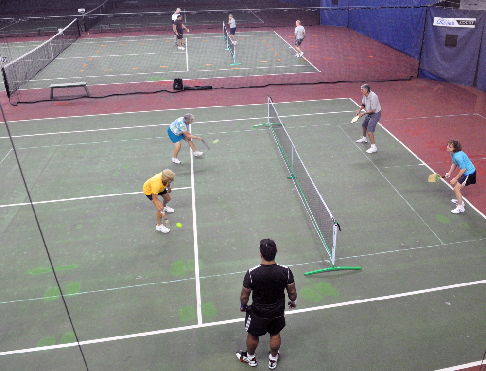 People play four games in the space of two tennis courts during a pickleball clinic on Saturday at A-COPI Tennis and Sports Center in Augusta.