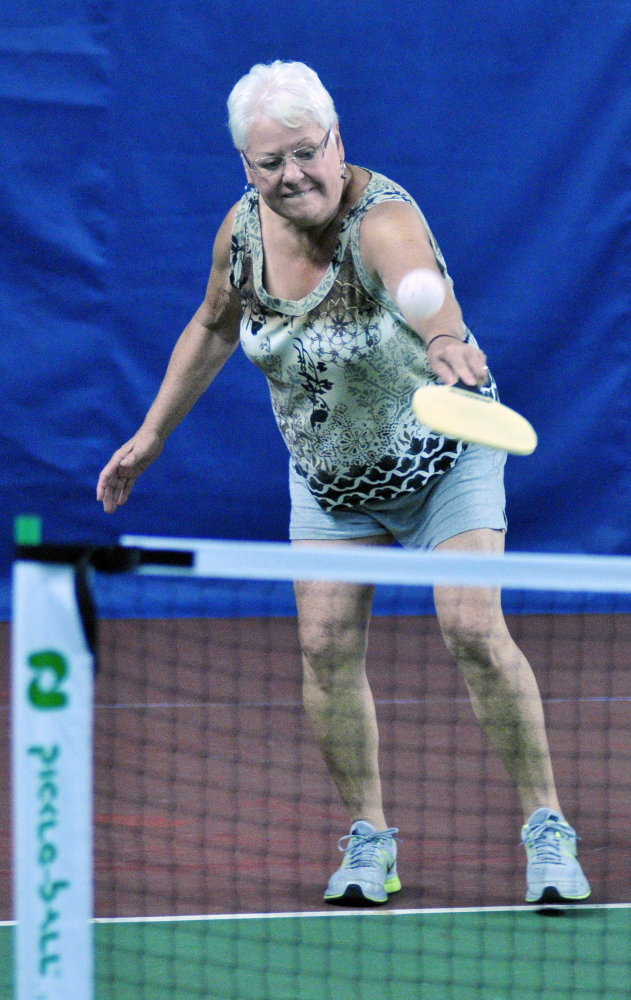 Carol Jowdry returns a shot during a pickleball clinic on Saturday at A-COPI Tennis and Sports Center in Augusta.