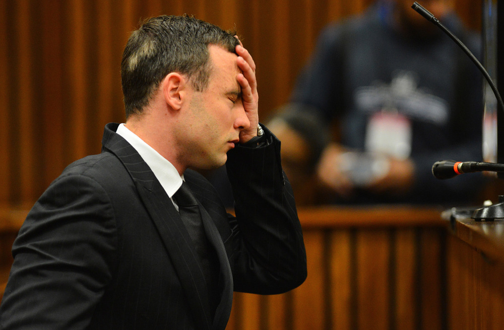 Oscar Pistorius listens to evidence in court in Pretoria, South Africa. The murder trial of Pistorius resumed Monday,after one month during which mental health experts evaluated the athlete to determine if he has an anxiety disorder that could have influenced his actions on the night he killed girlfriend Reeva Steenkamp.