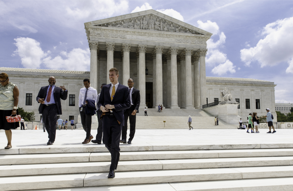 People leave the Supreme Court in Washington, Thursday, June 26, 2014, in the final days of its term.