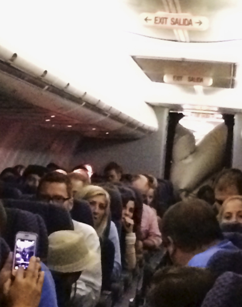 This photo provided by Michael Schroeder shows an emergency chute after it inflated inside a United Airlines plane on Sunday, filling part of the cabin and forcing the pilot to make an emergency landing in Kansas. United officials said no one aboard was injured.