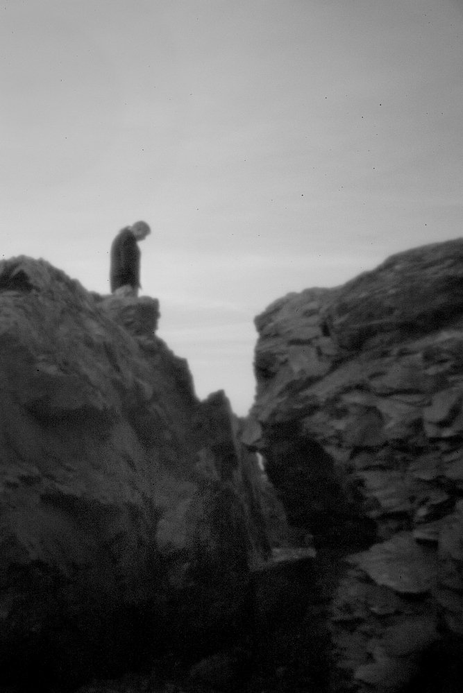Allen Sockabasin, a member of the tribe seen through the aperture of a pinhole camera, stands on Split Rock at the Pleasant Point Indian Reservation on April 30. Split Rock is of great spiritual significance to the Passamaquoddy, a tribe with two reservations in Washington County, Maine. Read more about the pinhole technique, PAGE A12
