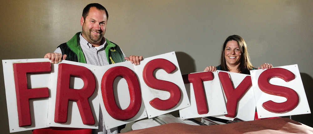 Staff photo by Joe Phelan New Shop: Nels Omdal, left, and Shelby Omdal hold up letters in 347 Water St. on Wednesday in downtown Gardiner. They'll be opening a new Frosty's Donuts there later this month. They said that the letters first hung in 1972 at the original Frosty's in Brunswick.
