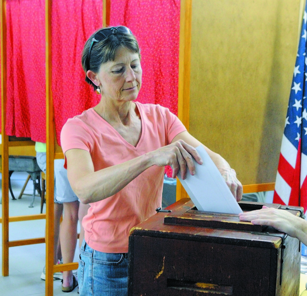 Staff file photo by Joe Phelan Town Meeting: Fayette residents will decide June 14 whether to continue to maintain Starling Hall, which has been used as a polling place.