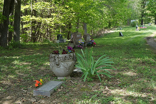 Maureen Milliken Photo SAD ROW: The graves of Bobby Dee Lane, who died at the age of 1, and Jeffrey Scott Lane, who died when he was 4, are in the foreground of a sad row at North Fairfield Friends Cemetery. To the left center is Nathan P. Morin's grave and the red bench at Avery Lane's grave can be seen in the back. Avery died in 2012 at age 6.