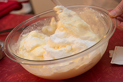 Susan Axelrod prepares Honey-Vanilla Cream with milk and eggs from the farmers market. The two versions of the dessert varied quite a bit in taste, she said.
