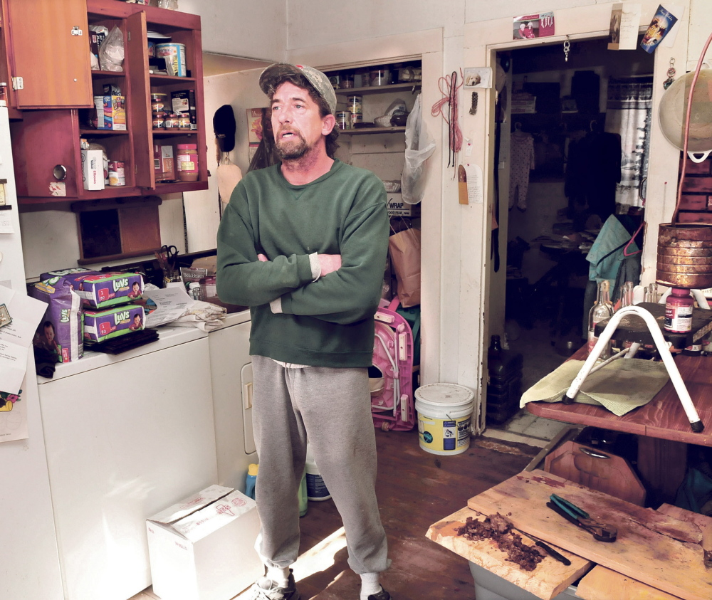 Staff file photo by David Leaming HOME UNREST: Wilton homeowner Duane Pollis speaks in January from inside his house.