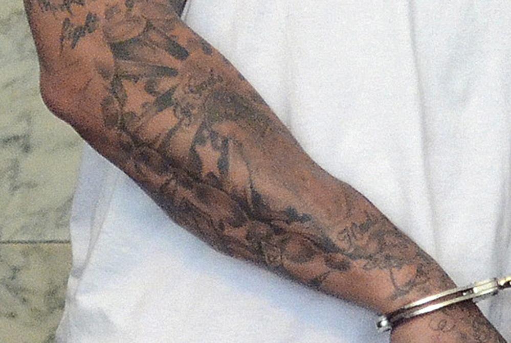 The Associated Press A detail of a June 26, 2013, photo, shows some of the five stars tattooed on the right forearm of former New England Patriots tight end Aaron Hernandez. While many star tattoos have nothing to do with crime, they can sometimes be used to represent killings.