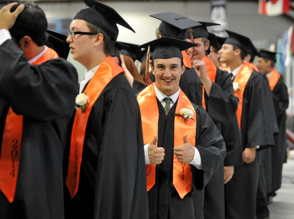 Staff photo by Michael G. Seamans READY TO GO: Winslow High School's class of 2014 prepares for commencement ceremonies at the Alfond Athletic Center at Colby College in Waterville on Wednesday.
