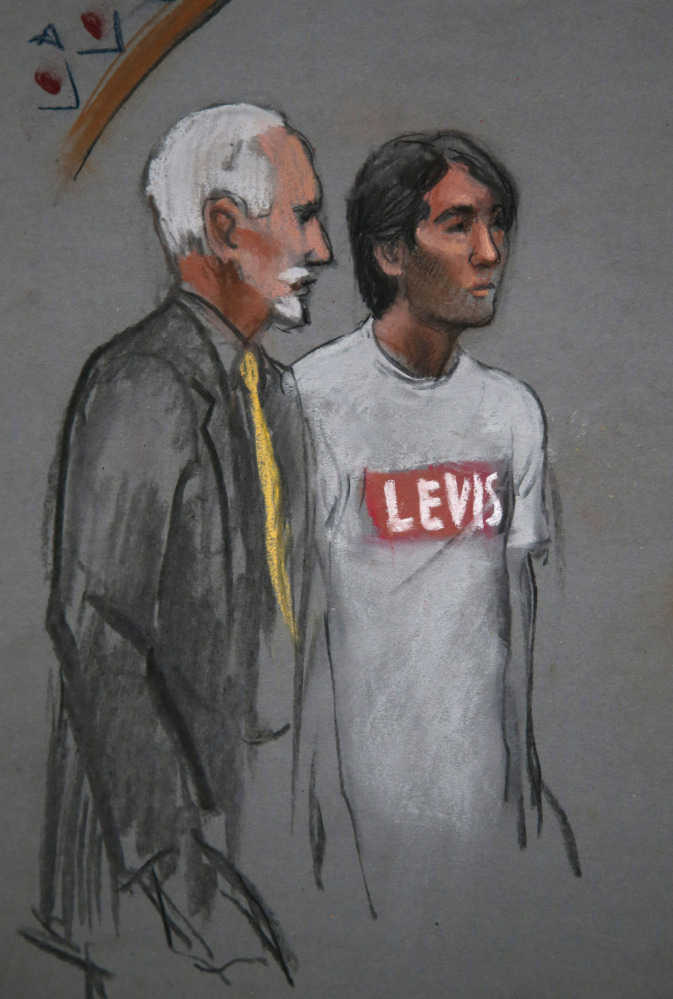 The Associated Press In this courtroom sketch, Khairullozhon Matanov, with attorney Paul Glickman, appears in federal court before Magistrate Judge Marianne B. Bowler last month.