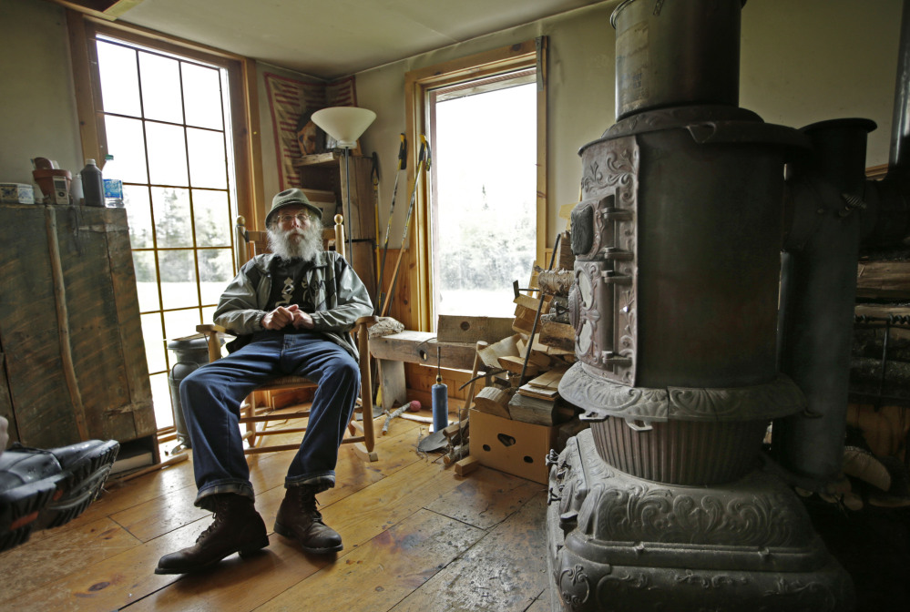 The Associated Press/Robert F. Bukaty Burt Shavitz rests inside his camp on his property in Parkman.