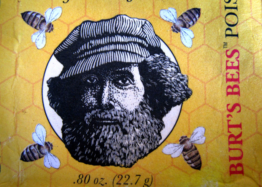This photo taken on Friday, May 23, 2014, shows a wrapper from a package of Burt's Bees soap features an image of Burt Shavitz, the Burt behind Burt's Bees. Shavitz still lives in rural Maine after leaving the company that was later sold for millions by his former business partner, Roxanne Quimby.  (AP Photo/Robert F. Bukaty)