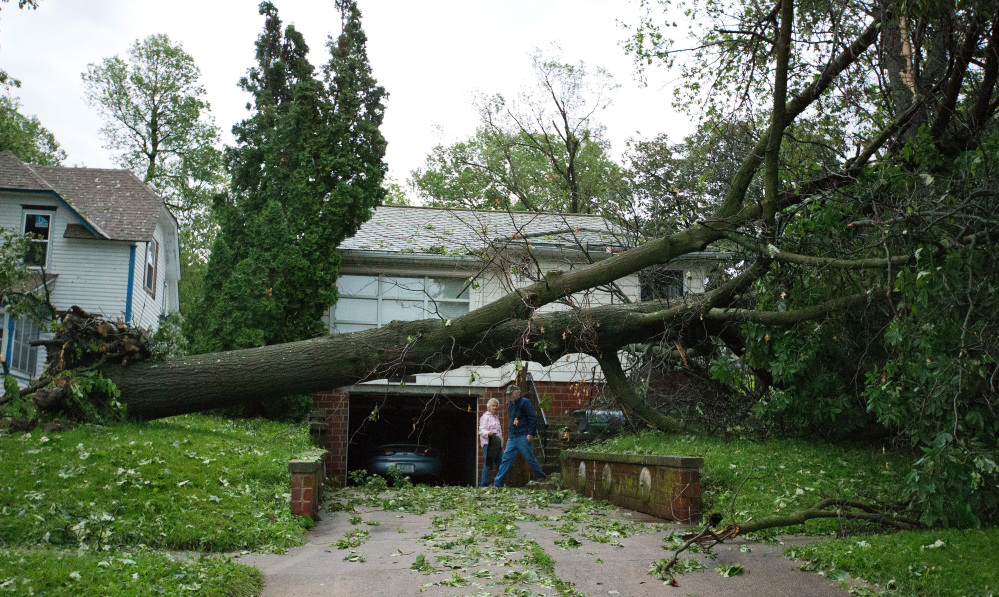 The Associated Press Dick and Laurel Rapp survey the damage to their home on Park Street in Oakland, Iowa, on Tuesday.