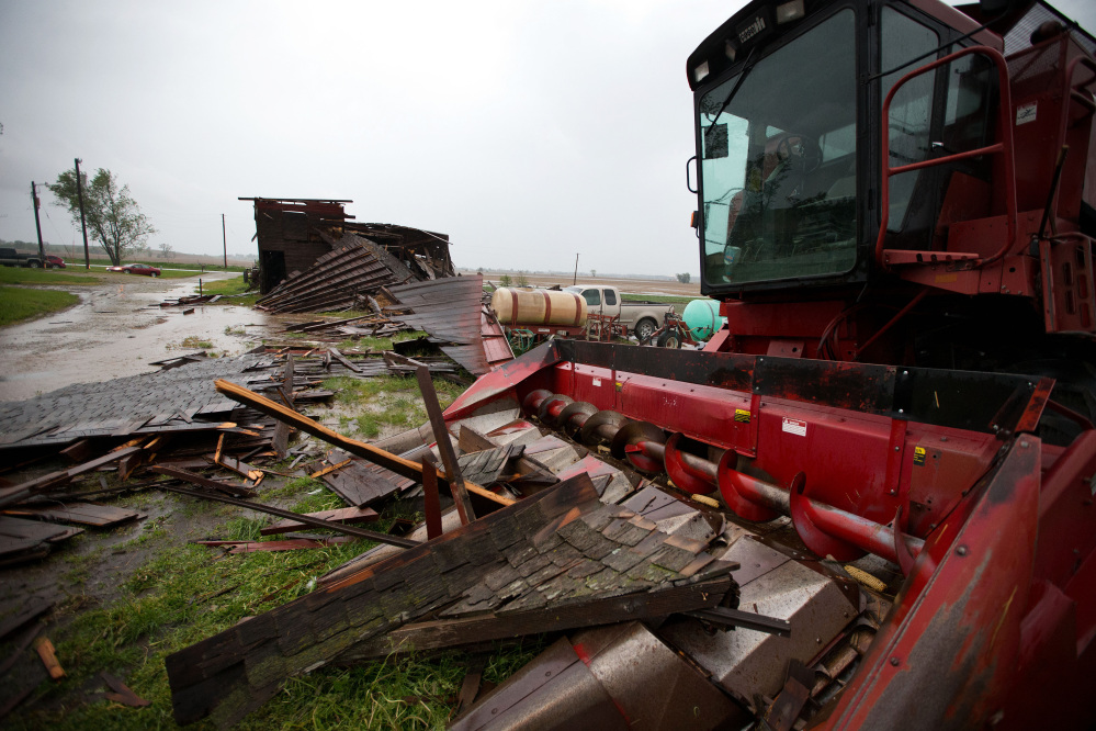 The Associated Press A destroyed barn is seen in Oakland, Iowa, on Tuesday. Severe weather packing large hail and heavy rain rolled into Nebraska and Iowa on Tuesday as potentially dangerous storms targeted a swath of the Midwest, including states where voters were casting ballots in primary elections.